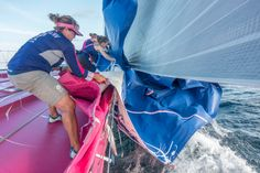 January 19, 2015. Day 16 of Leg 3 to Sanya onboard Team SCA. Sally Barkow helps pull the J1 sail on board after the Team changes sails. Corinna Halloran/Team SCA/Volvo Ocean Race