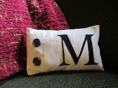 Fun with interfacing pt.2: monogrammed pillow slip-covers.  Make your own seasonal or holiday themed slip-covers with applique to change out and spice up your living room any time, on the cheap-cheap!