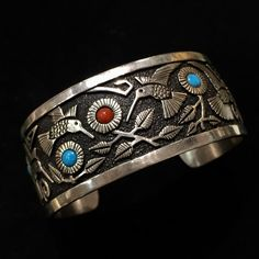 Large Sterling silver cuff with coral and turquoise beads.