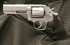 Clark Custom Smith and Wesson 686 .357 Magnum Revolver.  Target Action Job, Hard Chrome, Weigand Interchangeable front sight system with custom neon yellow insert front sight.