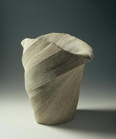 Sakiyama's carved and rippling surface patterns reinforce the surging, spiraling nature of his remarkable double-walled vessels –– form and surface influence the other, and work together to yield objects that are sensuous, bold and seamless. Some vessels appear as if made from sand on the beach, the surface simply decorated by the current of the receding water. Others appear to undulate and twist in space as if in perpetual motion.