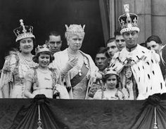 The Crown Jewels.  King George VI and Queen Elizabeth, the Queen Consort,  make an appearance after their coronation ceremony with Queen Mary and  the young princesses Elizabeth and Margaret on the Buckingham Palace  balcony in 1937. The Queen Consort is wearing the coronation crown that  includes the famous 106 carat Koh-i-Noor Diamond