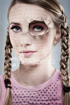 Woman With Paper Face and Hole Ripped Over Eye Royalty Free Stock Photo