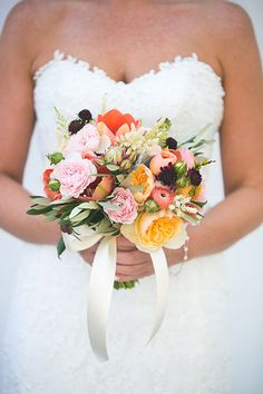 Bright Bouquet of Garden Roses and Ranunculus | Brides.com