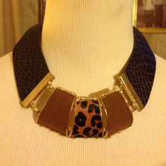 Gorgeous animal print suede leather necklace Brand new gold leather and suede animal print bib necklace not known Jewelry Necklaces