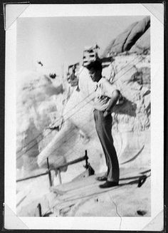 Dad at Mount Rushmore standing on Lincoln's head during construction