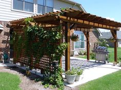 Awesome pergola! Now we just need some cool furniture and a fire pit