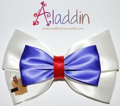 A medium (4 inches) hair bow inspired by Disneys Aladdin.    Choose your clip type using the drop down menu above the add to cart button on the