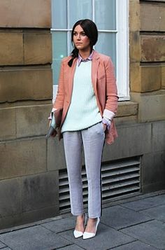 Pastel sweater paired with tuxedo pants