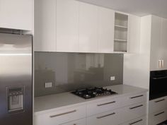 White kitchen, grey splashback - concealed rangehood