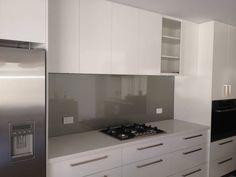 White kitchen, grey splashback - concealed rangehood