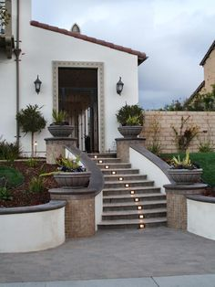 Steps Leading From The Driveway To The Courtyard Of This Southwestern Style  Home Are Lit On Each Riser. A Mulched Garden Of Ornamental Grasses And  Topiary ...