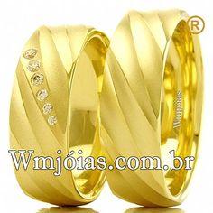 Aliança de noivado e casamento Aliança em ouro amarelo 18k 750 Peso: 16,00 gramas o par Pedras: 6 diamantes de 1 ponto Altura : 1,00 mm largura: 7,00mm Anatômico baixo  Acabamento fosco