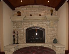 Custom built limestone fireplace with cast stone mantel