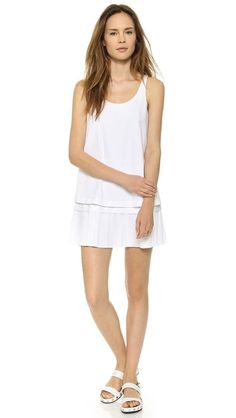 DKNY Drop Waist Tunic Dress This DKNY dress puts a sweet spin on the drop-waist silhouette. Slits relax the bodice overlay, and accordion pleats lend swing to the skirt. Exposed back zip. Unlined.