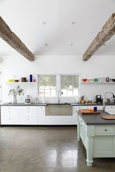 Tom Givone Floating Farmhouse in Upstate New York | Remodelista: bluestone countertops, vintage concrete sink, polished concrete floor