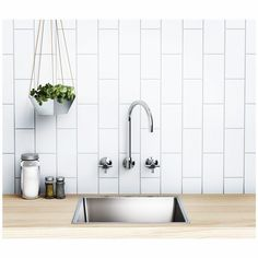 G E N X Mix up your kitchen look with a Phoenix Gen X Wall Sink Set. With its traditional look a wall sink set can be used in both your kitchen and laundry! We are also loving the vertical subway tiles for a change! Phoenix Gen X is available at Reece store. by phoenixtapware