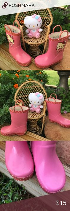 Hello Kitty Rain Boots and Hello Kitty Plush Hello Kitty pre-loved rain boots size 7-8 in great condition with minor wear see pictures. Sanrio/Hello Kitty Shoes Rain & Snow Boots