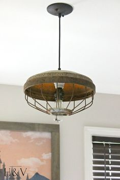 DIY industrial light made from a vintage chicken feeder. That's right, a chicken feeder.