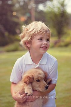 Photo session of an adorable 5 year old boy and his new golden retriever puppy. #photography