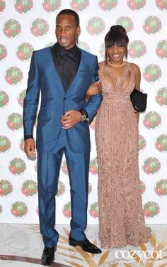 Chelsea football star Didier Drogba and wife Alla.    His wife is good looking (peeps say she looks like Naomi Campbell but I don't see that) BUT he out shine her in this tailor suit. I not feeling the black shirt w/ black bow-tie but the suit fits so damn good I could over look it.