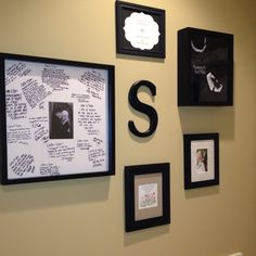 My mini wedding wall.  - Big framed signed by our entire wedding party  - program framed - ceremony lyrics in a frame with ceremony picture  - Peyton's tux in a shadow box - invitation a friend had painted and framed   Pinterest idea :)
