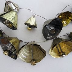 Tin Can Bell Garland - my grandpa made these from tin can lids. The sides had crimps all the way around. These are a bit more primitive looking. A fave of mine!