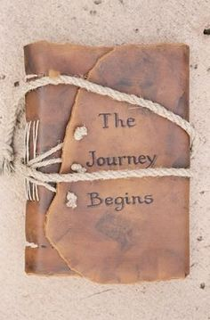Rustic wedding idea: use rope-closured, leather bound journal as guest book.