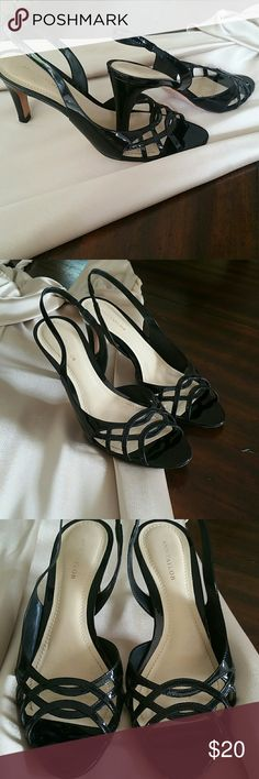 """Ann Taylor patent leather slingback heels Adorable black patent leather slingback heels/sandles from Ann Taylor, sz 7.5.  In EUC with general wear on soles (see pics).  No scratches to heels or leather, top is like lattice work.  Worn a handful of times, is definitely  a wardrobe staple!  Heels 3"""" tall.  They are true to sz, a 7.5.  Would not fit a wide foot or one that's closer to an 8.  There's no stretch, so they've stayed a true 7.5.  They need a new home!! Ann Taylor Shoes Heels"""