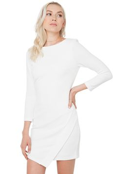 AKIRA's You Got Me Off White Dress features a high neckline, low v-cut back, 3/4 length sleeves, back strap detail, asymmetrical pointed hem at front, a stretchy ribbed body, and an invisible back zipper closure. Free standard U.S. shipping $75+.