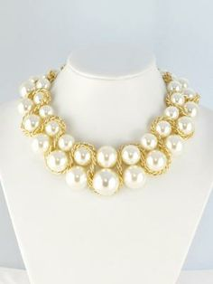 Pretty pearl necklace. Pair up with flowing maxi dress and brown sandals for a lovely beach escape outfit.
