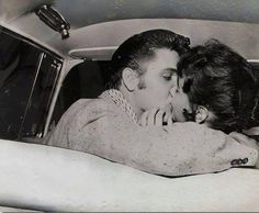 Elvis Presley and his Memphis sweetheart Barbara Hearn at Fairgrounds Amusement Park in Memphis, TN on Tuesday, June 19, 1956. This photo by photographer Robert Williams was part of a photo shoot following Elvis at home, and downtown Memphis.