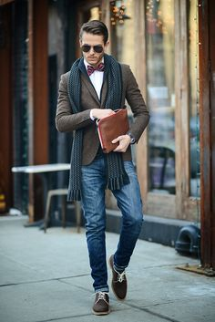 Shop this look for $308:  http://lookastic.com/men/looks/bow-tie-and-dress-shirt-and-shawl-cardigan-and-scarf-and-blazer-and-jeans-and-oxford-shoes/1262  — Red Plaid Bow-tie  — White Dress Shirt  — Navy Shawl Cardigan  — Navy Print Scarf  — Chocolate Wool Blazer  — Blue Jeans  — Chocolate Suede Oxford Shoes