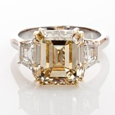 I'm resetting my three-stone emerald-cut diamond engagement ring. Emerald Cut Rings, Diamond Rings, Diamond Engagement Rings, Diamond Jewelry, Solitaire Engagement, Champagne Diamond, Colored Diamonds, Pink Diamonds, Beautiful Rings