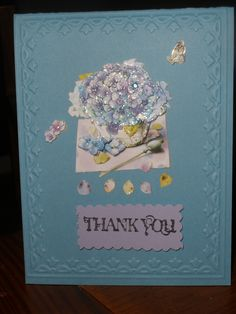 Embossed Thank you card.  Got the 3D stickers from the Dollar Tree.