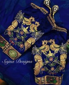 Beautiful royal blue color designer blouse sleeves with peacock and parrot design hand embroidery work. call/message at +919094871467 . 07 July 2017