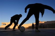 6 January 2013 - Boys play football in an area of Sirte, Libya, that was once contaminated with unexploded ordinance. Much of the city, the final stronghold of former government forces, was destroyed during Libya's civil war. The 10-month conflict displaced more than 200,000 Libyans and forced over 660,000 to seek refuge abroad before ending in October 2011. Recovery efforts are ongoing.  ©UNICEF/Giovanni Diffidenti  To see more: www.unicef.org/photography