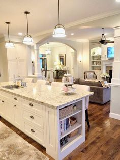 White kitchen, off-white cabinets, Sherwin Williams Conservative Gray, New Venetian Gold Granite, open layout, open floor plan, open concept, hickory wood floors