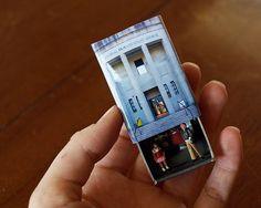 He encontrado este interesante anuncio de Etsy en https://www.etsy.com/es/listing/197112965/matchbox-building-matchbox-miniature-of