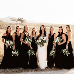 wedding bridesmaids Bridesmaids in black, the bride in all white, and tons of greenery + creamy florals to tie the look Bridesmaid Dresses Under 100, Black Bridesmaids, Bridesmaids And Groomsmen, Bridesmaid Gowns, Fall Wedding Bridesmaids, Black And White Wedding Theme, Black Tie Wedding, White Bridal, Black White Weddings