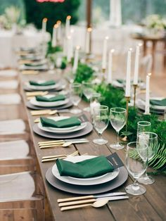 Modern, Tropical Wedding Tablescape // tapered candles, green linens, gold flatware, ferns, greenery, feasting tables