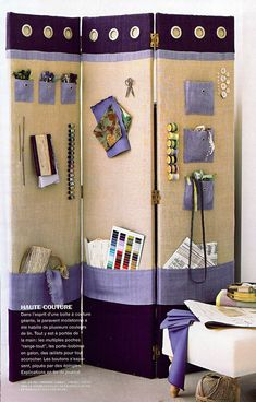 room divider with organizing for the side that faces the art studio area of the sunroom.