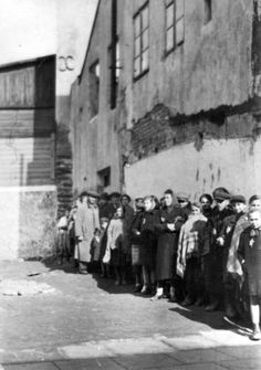 Lodz, Poland, 1940, Jews standing in an orderly manner in a ghetto street.