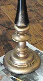 How To Give a Lamp a Facelift with Rub n Buff - it comes in shades of gold, silver, copper, etc.- a paste that you rub on & buff off!  Use it on hardware, furniture, walls, etc. to highlight details or completely cover a project.  It's a very easy way to transform an outdated piece.