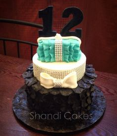 Teenage girls birthday cake by Shandi Cakes on top make sugar cookies with J R M. Without purse