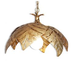 FRANCE Circa 1960  Vintage French gilded Mid-Century palm leaf chandelier that showcases six large palm leaves suspended from a chain and a single light bulb. Please notice the handmade texture especially visible around the edge of each leaf as well as the manner in which each leaf is pierced to enable light to shine through. Each leaf is gently curved to create a rounded appearance on the entire pendant. While the height of the shade measures 41 cm, the whole height of the pendant with the… Hollywood Regency, Palms, French Vintage, In The Heights, Light Bulb, Mid Century, Chandelier, Bling, Leaves