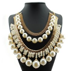 Pearl necklace Must have statement necklace. Ladies this is a beautiful piece with multilayered pearls. High quality material. Retail Jewelry Necklaces