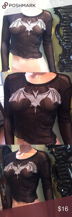 Gothic vampire bat black fishnet shirt M goth Very rare & vintage black long sleeve fishnet shirt w white vampire bat. Super cute and stretchy. Marked M in good used condition- not hot topic but put it here to be seen - bought at a store in the east village NYC that is no longer there. Hot Topic Tops Tees - Long Sleeve
