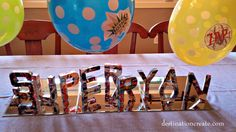 Paper mache letters: Super Hero Party...Little one year old Ryan needed to be revived a couple of times earlier this year... For his first birthday a Super Hero Party was a must for this little miracle baby with his Super Survival Powers.  Read details at http://destinationcreate.com/super-hero-party/  #super hero party #kids party #comic book party