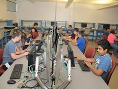 Kids in fifth through ninth grade learn python code for the Minecraft computer game during the Programming with Raspberry Pi class, part of the MCC Tech Camp program at McHenry County College. The instructor is MCC's Digital Media instructor Meri Winchester.